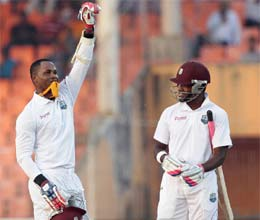 samuels blasts double century as bangladesh toil