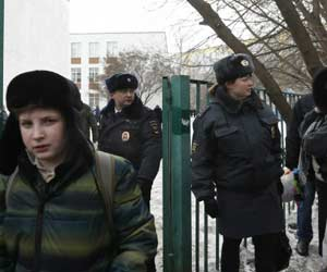 Student kills teacher policeman in Moscow school