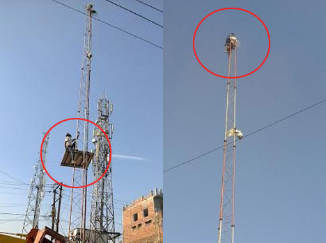 man climbed on mobile tower