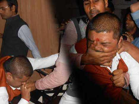 sp workers beat shiv sena leader.
