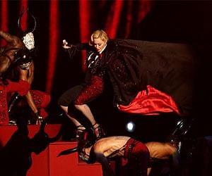 pop star Madonna falls off stage