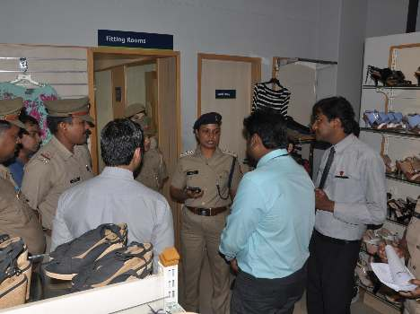 Police search hidden camera shopping malls .