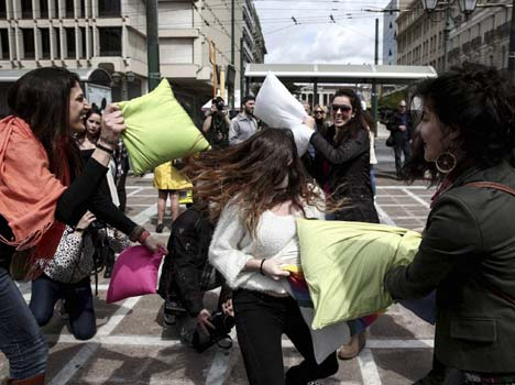 youths participate in pillow fight.