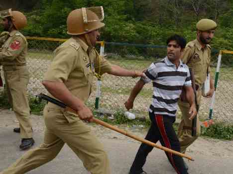in pictures, lathi charge on kashmiri pandits