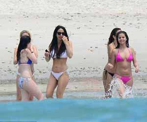 Selena Gomez flaunts her slender curves and ample cleavage in a skimpy pink bikini