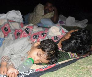 people sleep in gardens in fear of earthquake