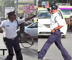 Police cop control traffic by help of michael jackson dance