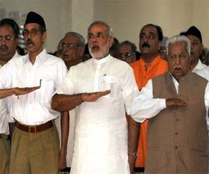 rss praise modi government on completing one year