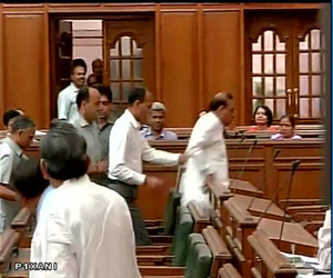 Pics : BJP MLA forcibly removed from Delhi Assembly