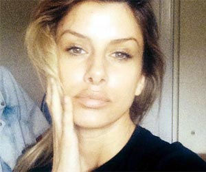 Playboy model linked with 5 MURDERS and multiple robberies