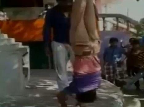 The neighbor beaten a child hanging upside down