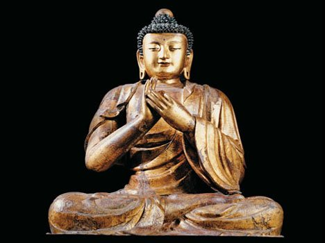 What meaning do the features and gestures of the Buddha convey?