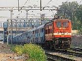 women travellers push tte from running train