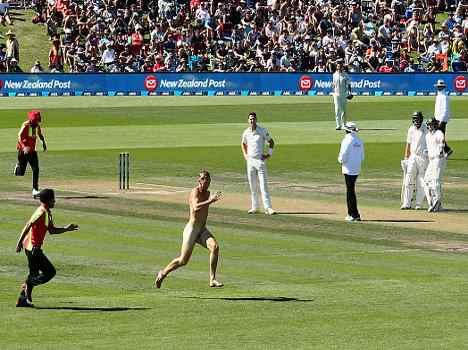 A streaker runs on the pitch At Christchurch test