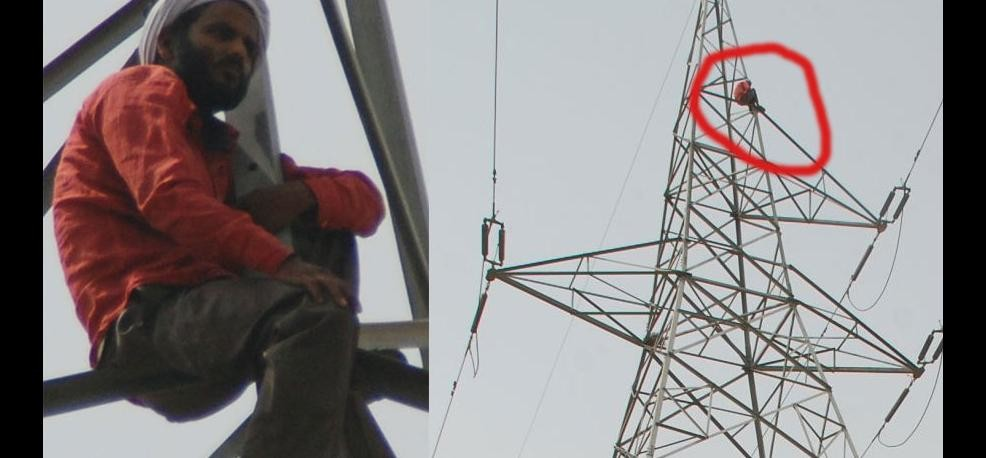 Man climbed on electric tower for search his missing wife.