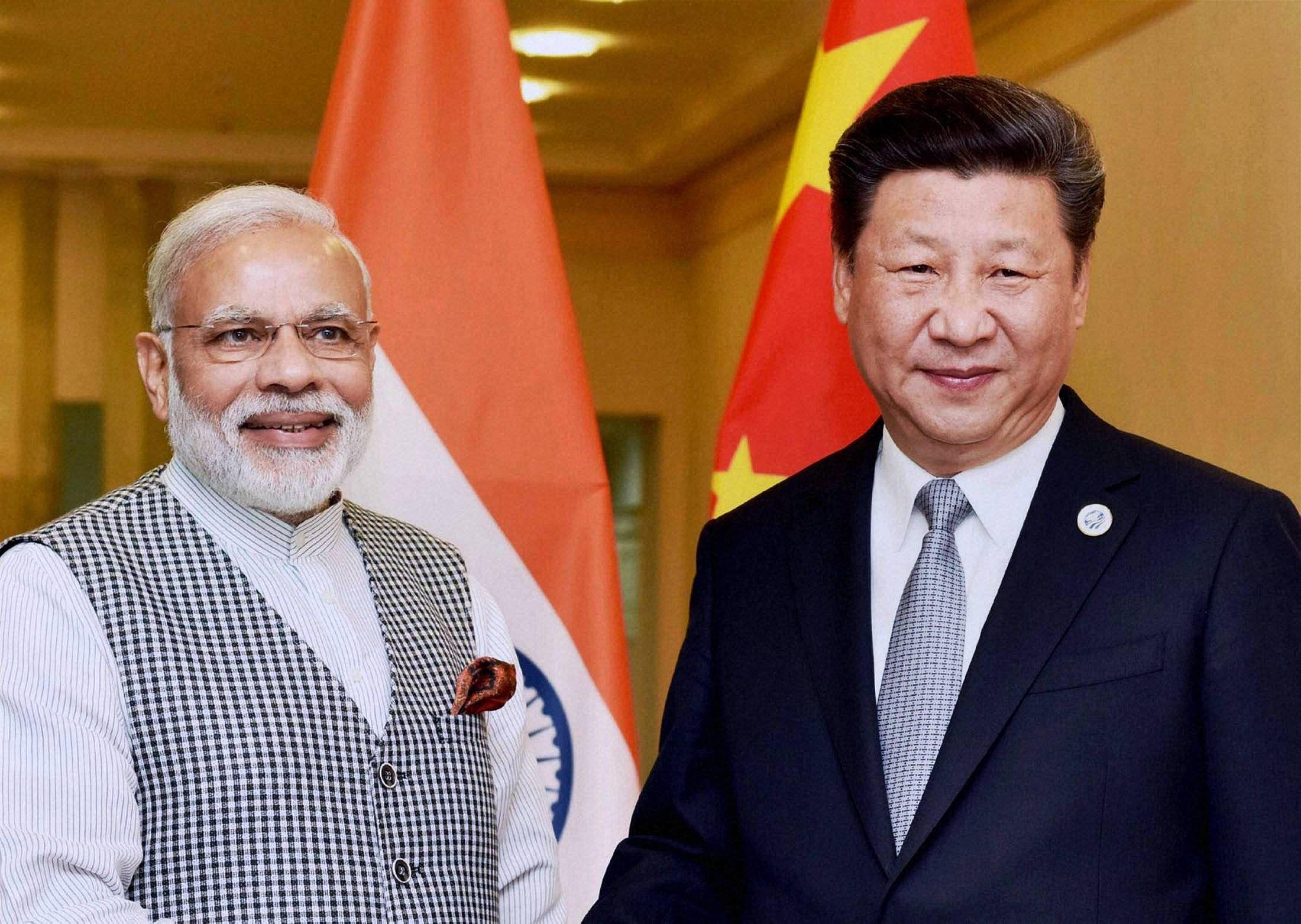 प्रधानमंत्री मोदी और चीन के राष्ट्रपति शी जिनपिंग (फाइल फोटो)