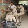 Police personnel fighting each other for bribe money