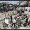 Bombings kill at least 50 in northeast Syria city