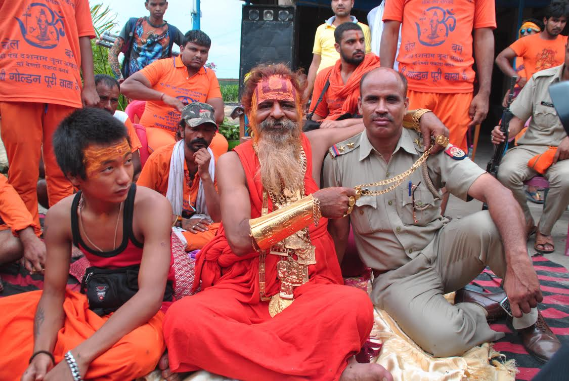 golden baba with policeman