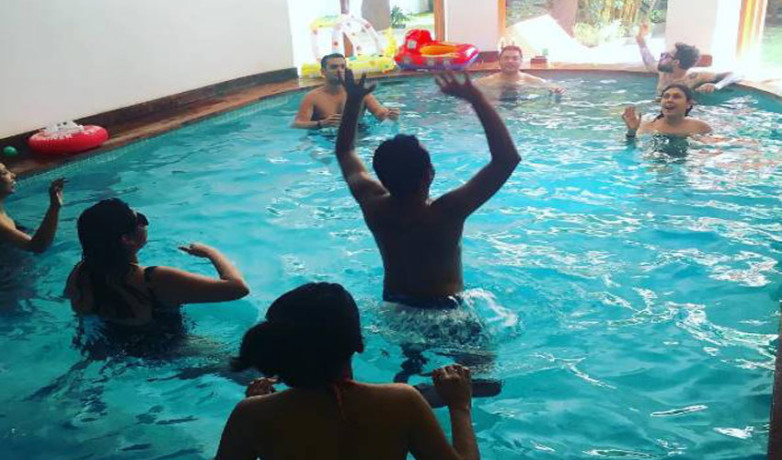 imran khan in pool with her wife and baby