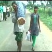 tribal man walked around 10km carrying his wife's body