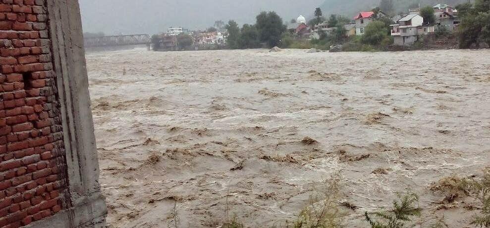 Sarbari river flowing above danger mark in Kullu Himachal pradesh