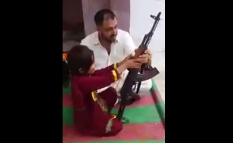 Pakistan little girl fired AK-47 and mention modi and india in viral video