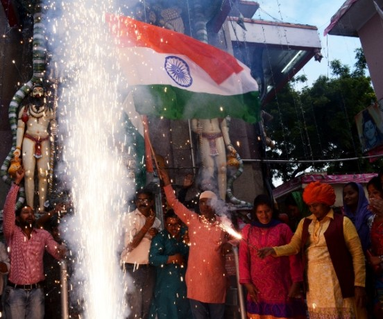 People celebrate the bravery of Indian army in Lucknow.