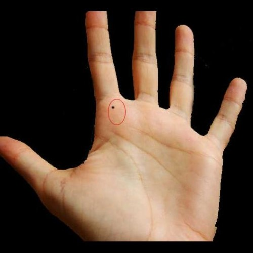 palmistry mole on hand meaning