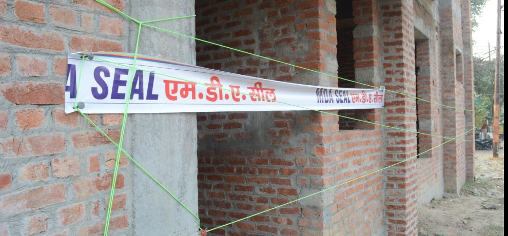 MDA seal illegal flats built on road
