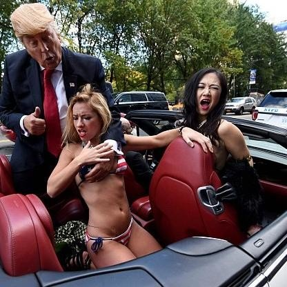 Bikini-Clad Models Surround Fake Donald Trump In New York City Stunt