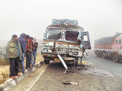 Truck collides with tanker in fog
