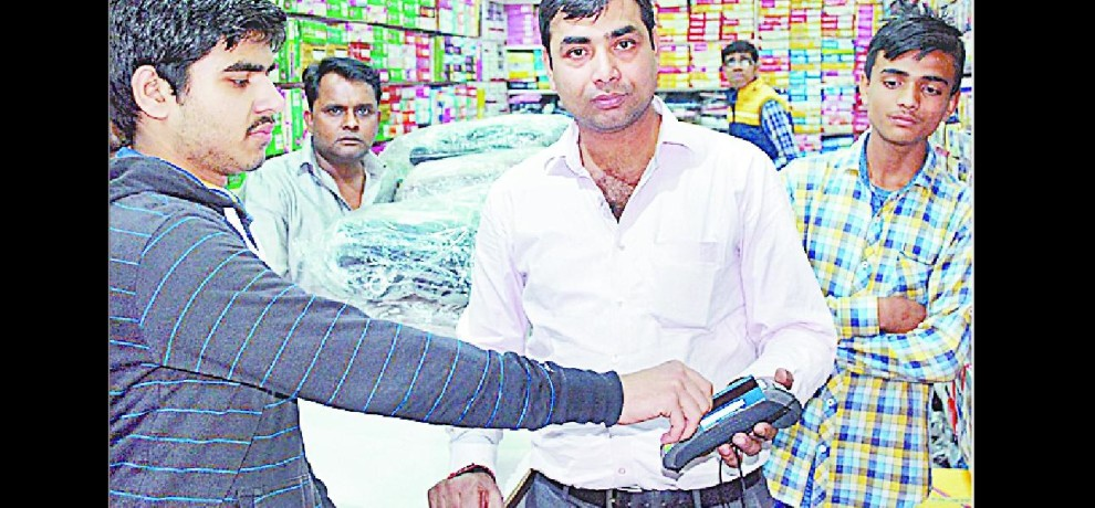 People line up in Shamli cashless shopping
