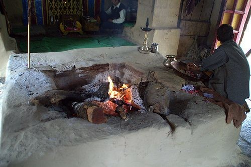 fire is burning in the temple from three eras