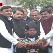 CM Akhilesh Yadav distributes tricycles to specially-abled children