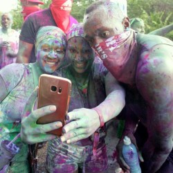 sain Bolt is covered in paint at amazing carnival party in Trinidad