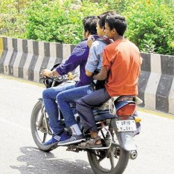 Do not ride your bike with three pillion rider