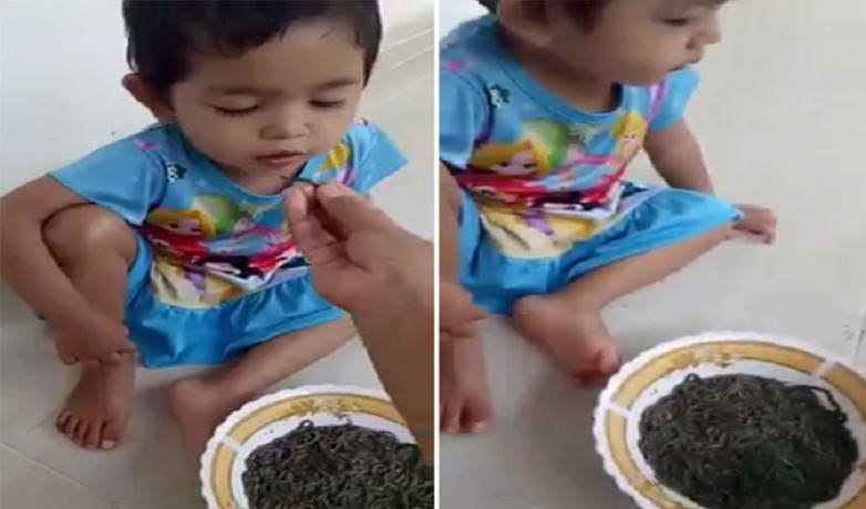baby feed alive earthworms by mother