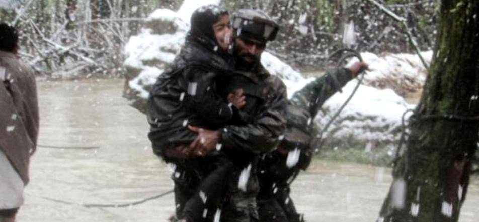 security PERSONNEL SAVING PEOPLE FROM FLOOD IN VALLEY