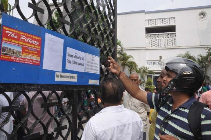CBSE sticked notice to cancel the affliation on the gate of pillars school