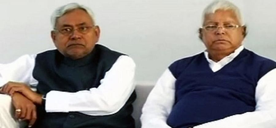 What is the secret of Nitish's silence on the raids against the Lalu family?