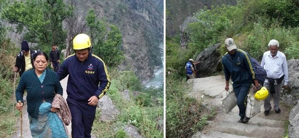 pilgrims are walking by foot after block badrinath highway