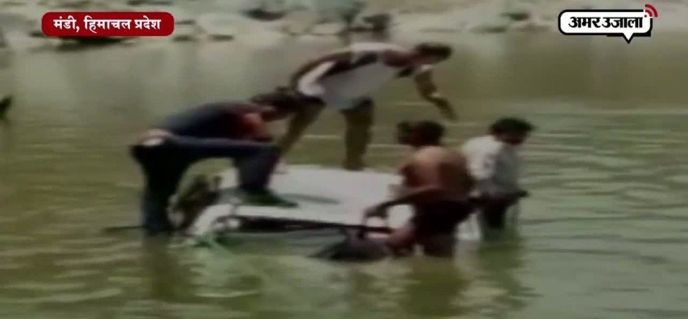 A CAR FALLEN INTO BYAS RIVER IN HIMACHAL PRADESH