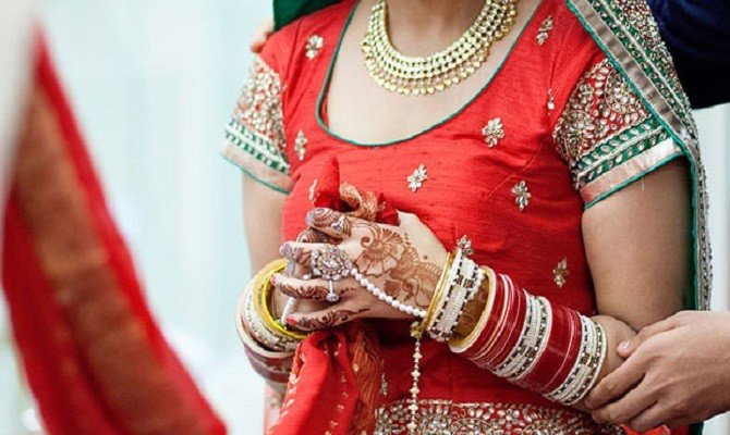 bride wears shorts and lahanga in her marriage