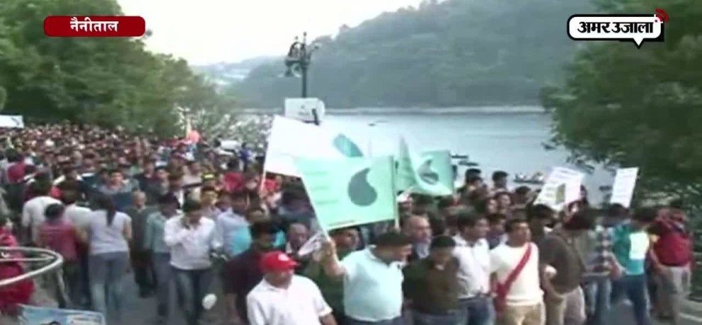 Tourists made foot march to draw administration's attention to preserve natural beauty of Naini Lake