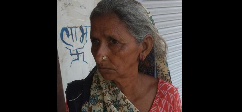 The door was opened by old lady, robbers  snatch her kundal