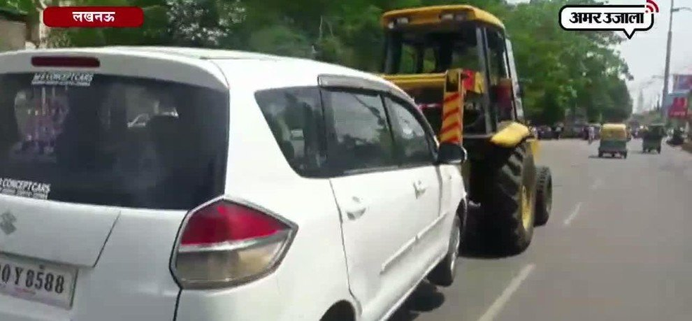TRAFFIC POLICE PICK UP A CAR IN HAZRATGANJ ALONG WITH THE CAR DRIVER