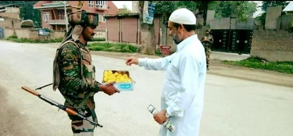 Army troops distributed sweets among people in kashmir