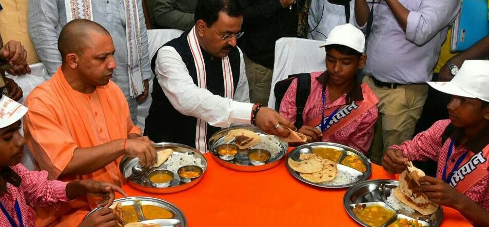 cm adityanath tastes midday meal with up school kids