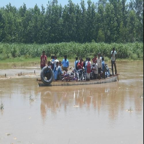 Rain havoc ... here students go to school by boat, view Photos